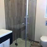 Frameless 90 degrees shower with glass shelves