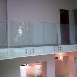 Frameless face mounted balustrade
