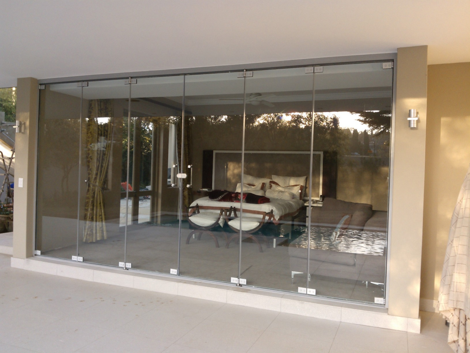 Folding sliding glass doors frameless nearly frameless for Pocket sliding glass doors