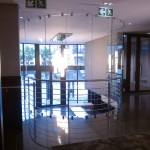 Frameless glass patitioning