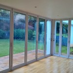 Sliding folding doors with double glazed glass
